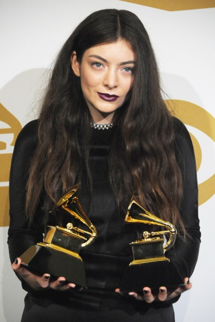 Lorde with her two Grammy awards she won with album Pure Heroin.